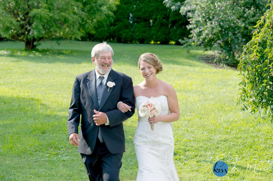 best wedding photographer in pennsylvania - monroe county wedding photographer - outdoor wedding ceremony - bride and groom walking down aisle