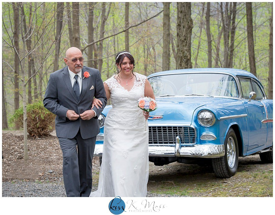 father walking bride down aisle for outdoor wedding ceremony